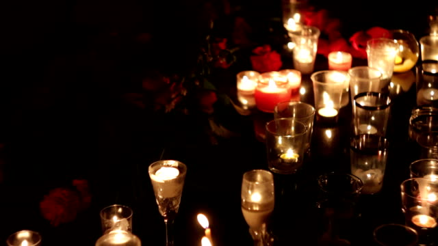 Memorial in honor of the victims of the victims of terrorism. People bring many flowers and candles to the place of death. People mourn. Policy, consequences of terrorism and military operations video
