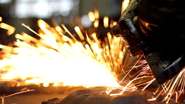 Men at work grinding steel video