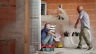 Men at work in construction site, manual workers video