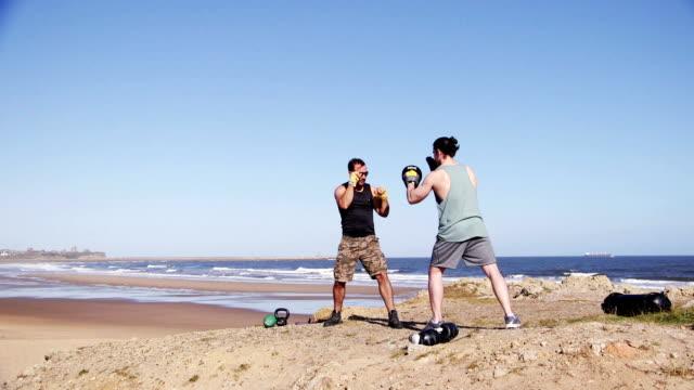 Men Boxing Training on the Beach video