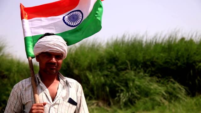 Men carrying national flag video