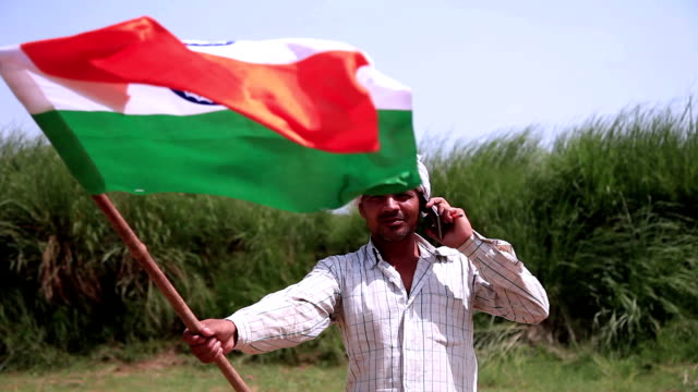 Men carrying national flag video