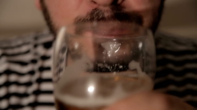 Men drinking beer,close up video