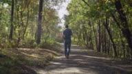 Men enjoy autumn in the forest video