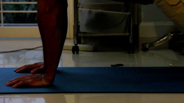 Men exercising via pushup video
