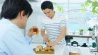 Men Hanging Out in Kitchen video