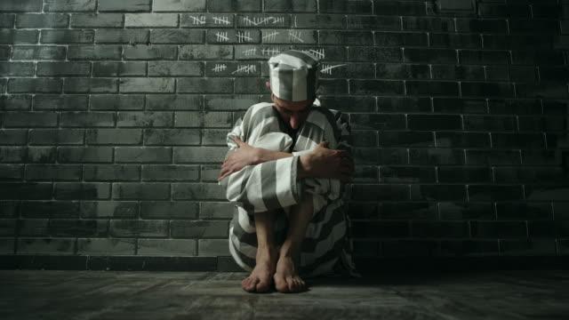 Men having abdominal pain at prison cell video
