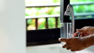 men hold glass to drink fresh water video