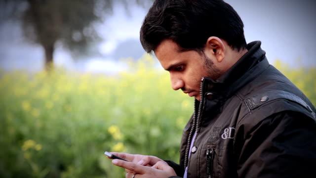 Men Holding Smartphone video