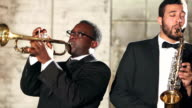 Men in jazz band on trumpet and saxophone video