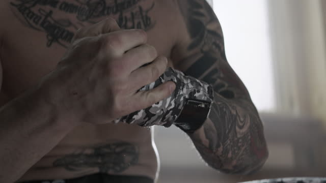 Men is wrapping hansd with boxing wraps video
