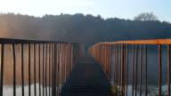 Men on bridge at sunrise video
