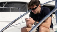 Men on the phone on yacht video