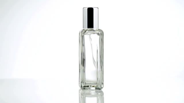 Men perfume. Bottle spray in rotation video