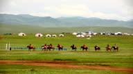 Men playing polo during Naadam Festival video