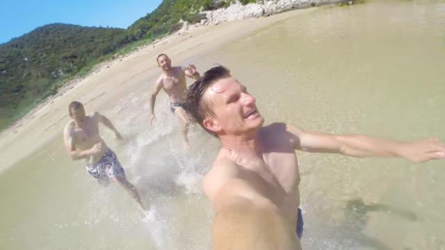 POV Men Running Into The Sea video