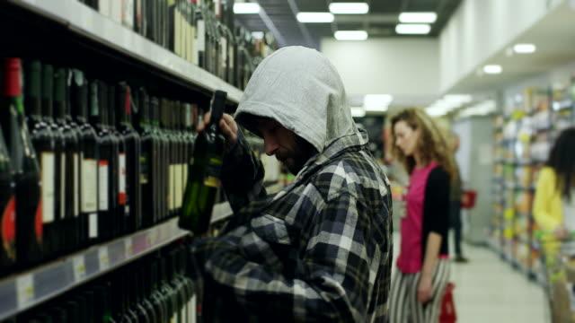 Men shoplifting in supermarket video