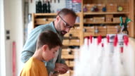 Men Shopping with son video