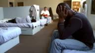 Men Sitting On Beds In Homeless Shelter video
