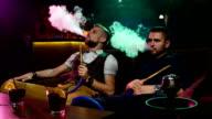men smoke from shisha pipei n the lounge caffee video