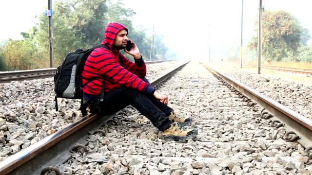 Men using Smart Phone near Railway Track video