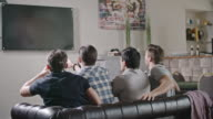 Men Watching Game and Celebrating Goal video