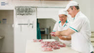 Men working at the butcher's shop video
