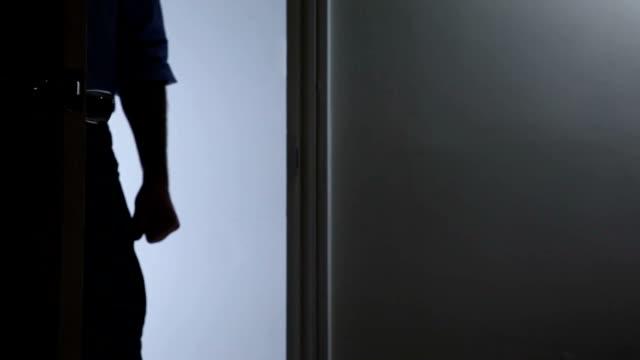 Menacing man in doorway. video