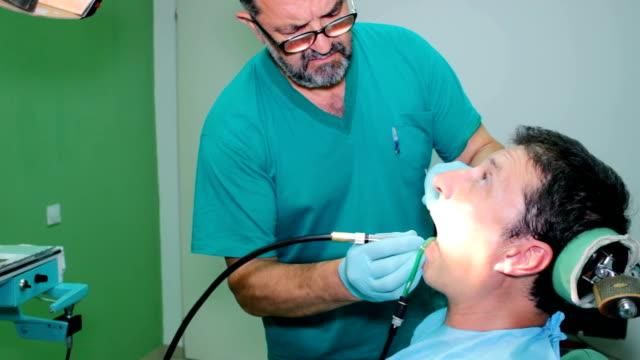 Mending patient's teeth video