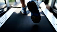 Men's foot running on the treadmill in the gym video