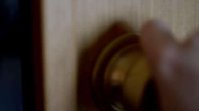 Men's hand closes the door. video