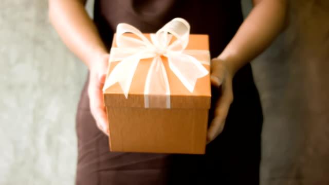 Men's hand holding gift box video
