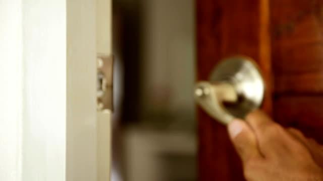 Men's hand open the door video