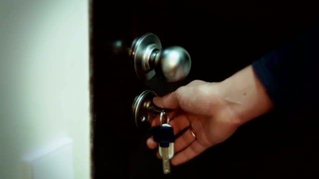 Men's hand opens the door video