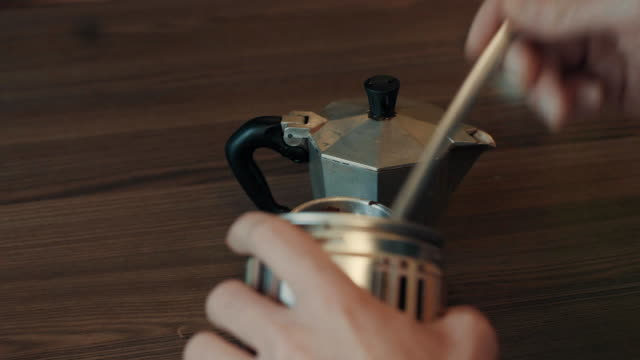 Mens hands preparing coffee in coffee geyser video