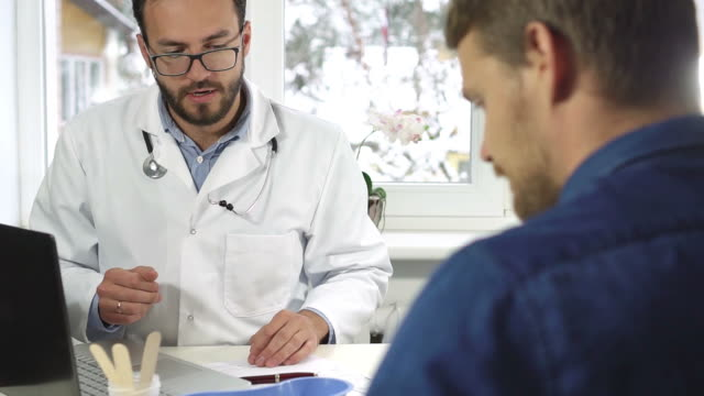 men's health - doctor giving consultation to male patient video