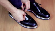 Mens Shoes Tied Together video