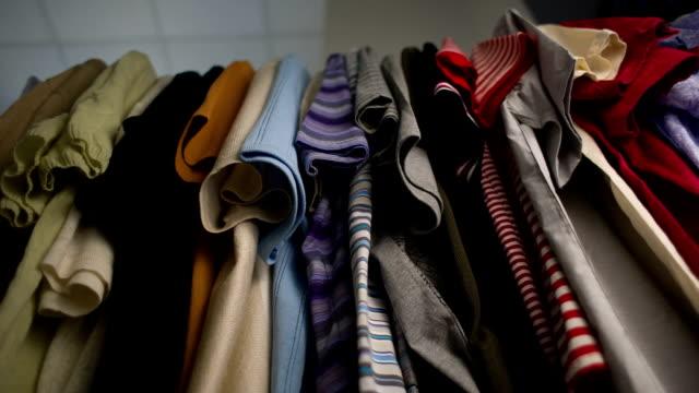 Men's T-shirts on hangers at wardrobe video