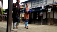 Merchants and Farmers Dressed in Traditional Costume in an Edo Era Japanese Village video