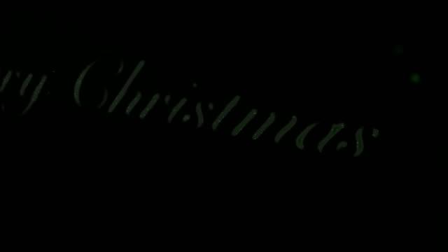 Merry Christmas and Swooshing Green Snowflake Comet video