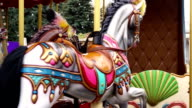 Merry-go-round carousel spinning around, entertainment outdoors, festival video