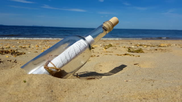 Message in a Bottle at Shore Beach 4K video