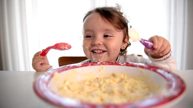 Messy Baby Girl Eating And Smiling video