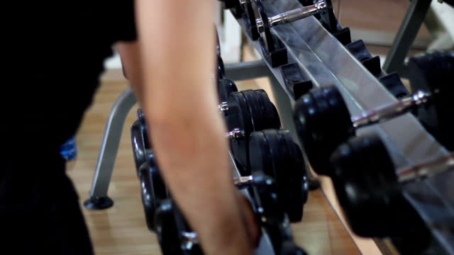 metal barbells on their stall. some people use them. video