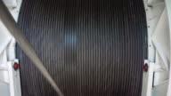 Metal rope wound on a big drum video