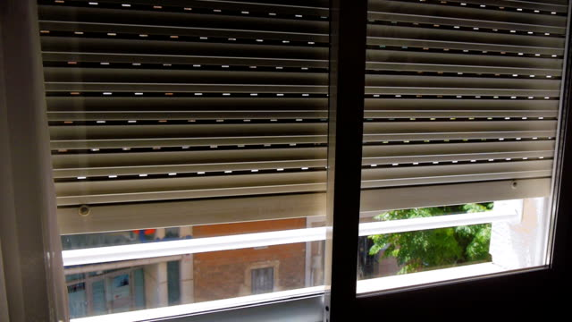 Metal window shutters are raised up video