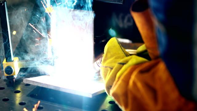 Metal worker welding in metal industry factory video