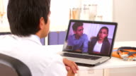 Mexican couple talking to their doctor via webcam video