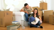 Mexican couple unpacking lamp video