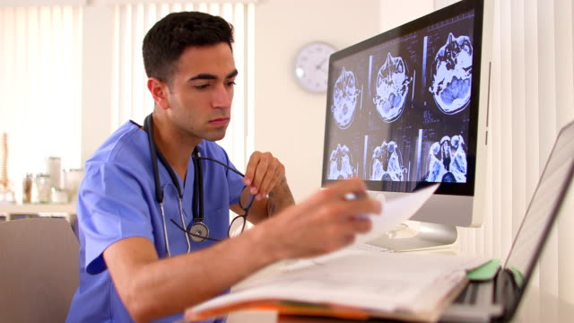 Mexican doctor analyzing brain x-rays video